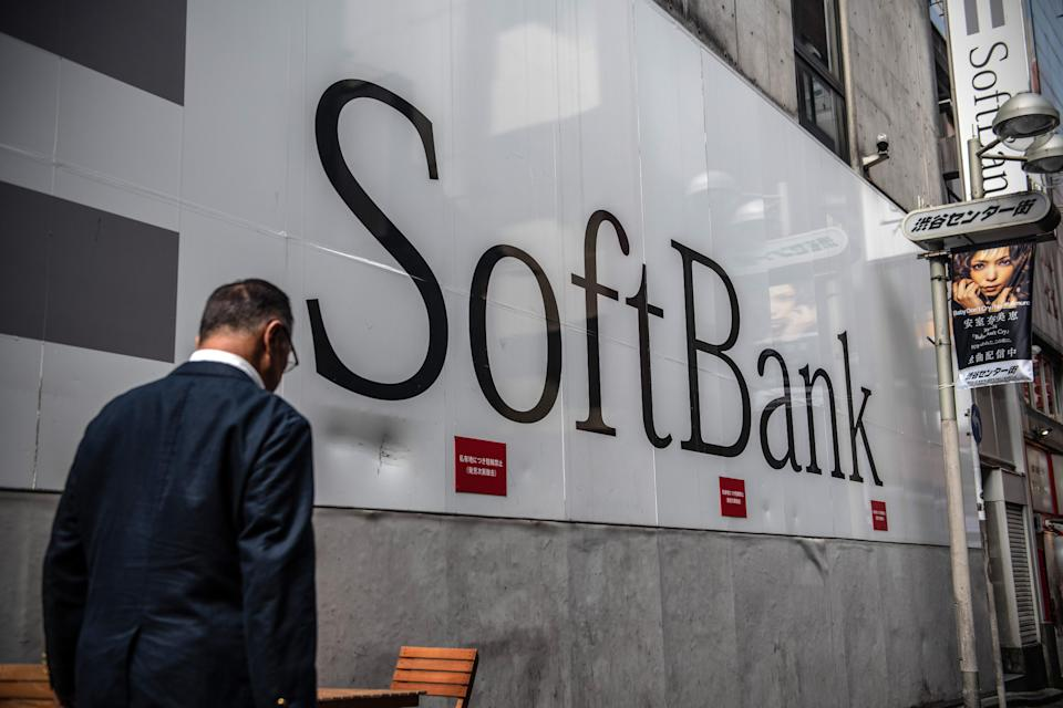 TOKYO, JAPAN - SEPTEMBER 30: A man walks past a SoftBank mobile phone store on September 30, 2019 in Tokyo, Japan. SoftBank, the technology and investment conglomerate owned by Masayoshi Son, is one of the largest investors in troubled American real estate company WeWork. (Photo by Carl Court/Getty Images)