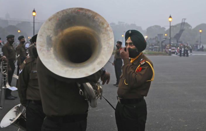 Army band soldiers talk as they prepare to march during rehearsals for the upcoming Republic Day parade at the Raisina hills, the government seat of power, in New Delhi, India, Monday, Jan. 18, 2021. Republic Day marks the anniversary of the adoption of the country's constitution on Jan. 26, 1950. Thousands congregate on Rajpath, a ceremonial boulevard in New Delhi, to watch a flamboyant display of the country's military power and cultural diversity. (AP Photo/Manish Swarup)