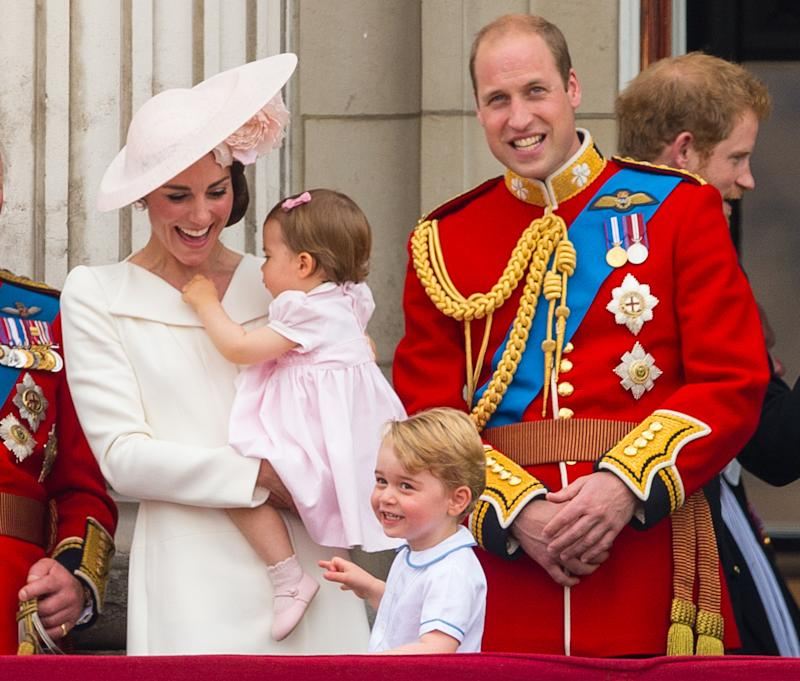 The Duke and Duchess of Cambridge with Princess Charlotte and Prince George on the balcony of Buckingham Palace (Dominic Lipinski/PA Wire)