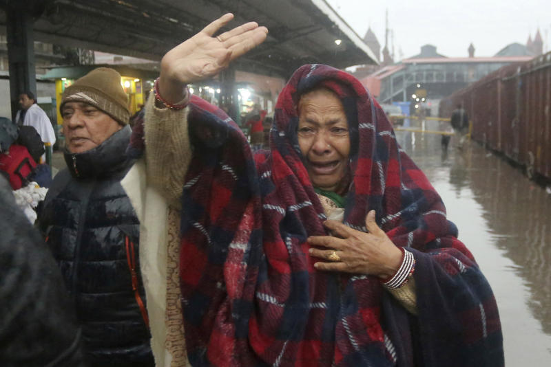 A Pakistani woman sees off her relatives travel to India via Samjhota Express at Lahore railway station in Pakistan, Thursday, Feb. 21, 2019. Indian authorities suspended a bus service this week without explanation. The development comes amid escalated tensions between Pakistan and India in the wake of last week's deadly suicide bombing in Kashmir against Indian paramilitary troops. (AP Photo/K.M. Chaudary)