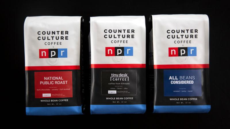 Three bags of NPR Counter Culture Coffee on a black background