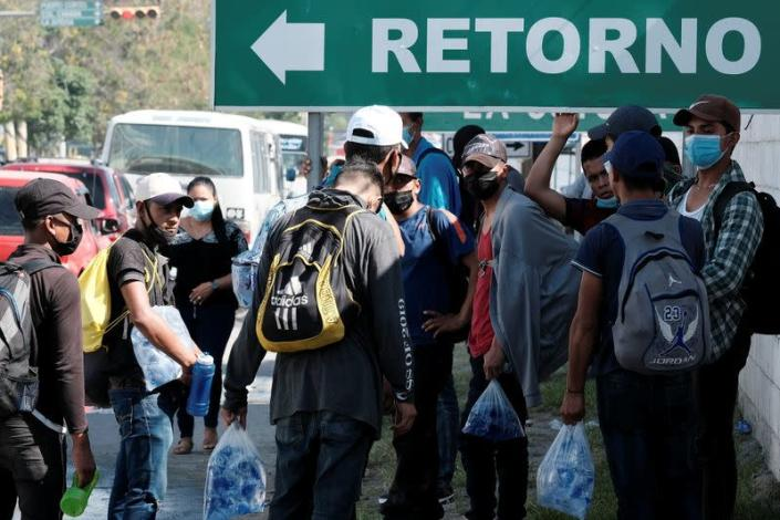 Hondurans take part in a new caravan of migrants set to head to the U.S., in Choloma