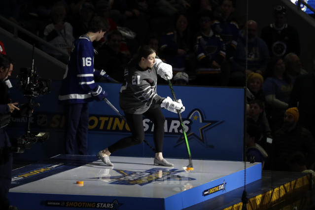 United States' Hilary Knight shoots during the Skills Competition shooting stars event, part of the NHL All-Star weekend, Friday, Jan. 24, 2020, in St. Louis. (AP Photo/Jeff Roberson)