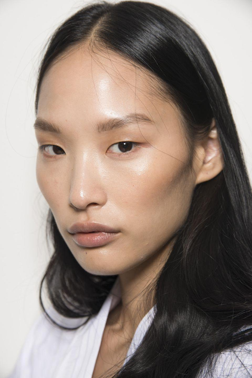 <p>One of spring's biggest trends is shaping up to be super-glossy skin with sheer, minimal makeup done in neutral and nude shades, like seen at Noon By Noor.</p>