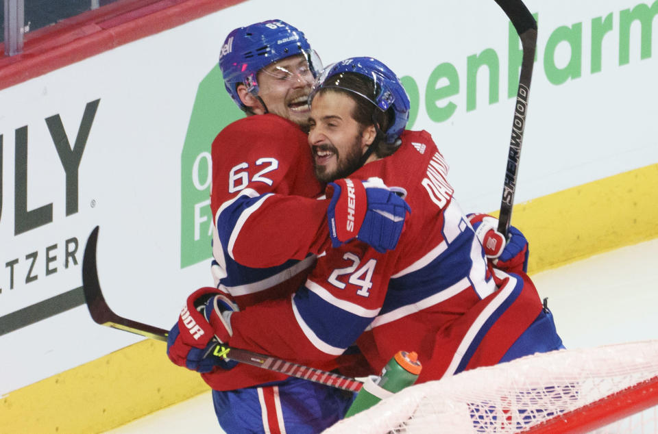 Montreal Canadiens' Artturi Lehkonen (62) celebrates his game-winning goal with teammate Montreal Canadiens' Phillip Danault (24) following overtime in Game 6 of an NHL hockey Stanley Cup semifinal playoff series against the Vegas Golden Knights Thursday, June 24, 2021 in Montreal. (Paul Chiasson/The Canadian Press via AP)