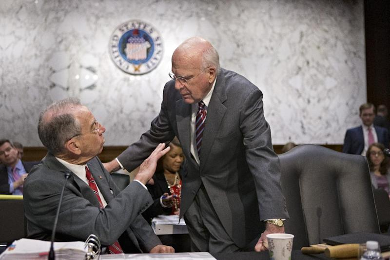 FILE - In this May 20, 2013, file photo Senate Judiciary Committee Chairman Patrick Leahy, D-Vt., right, confers with the committee's ranking Republican, Sen. Chuck Grassley, R-Iowa, on Capitol Hill in Washington as the committee assembles to work on the landmark immigration bill. Internal divisions within the Republican party, deeply held differences over policy, concerns over costs and more add to the complexity of the legislation that Senate Majority Leader Harry Reid has said must come to a final vote by July 4. (AP Photo/J. Scott Applewhite, File)