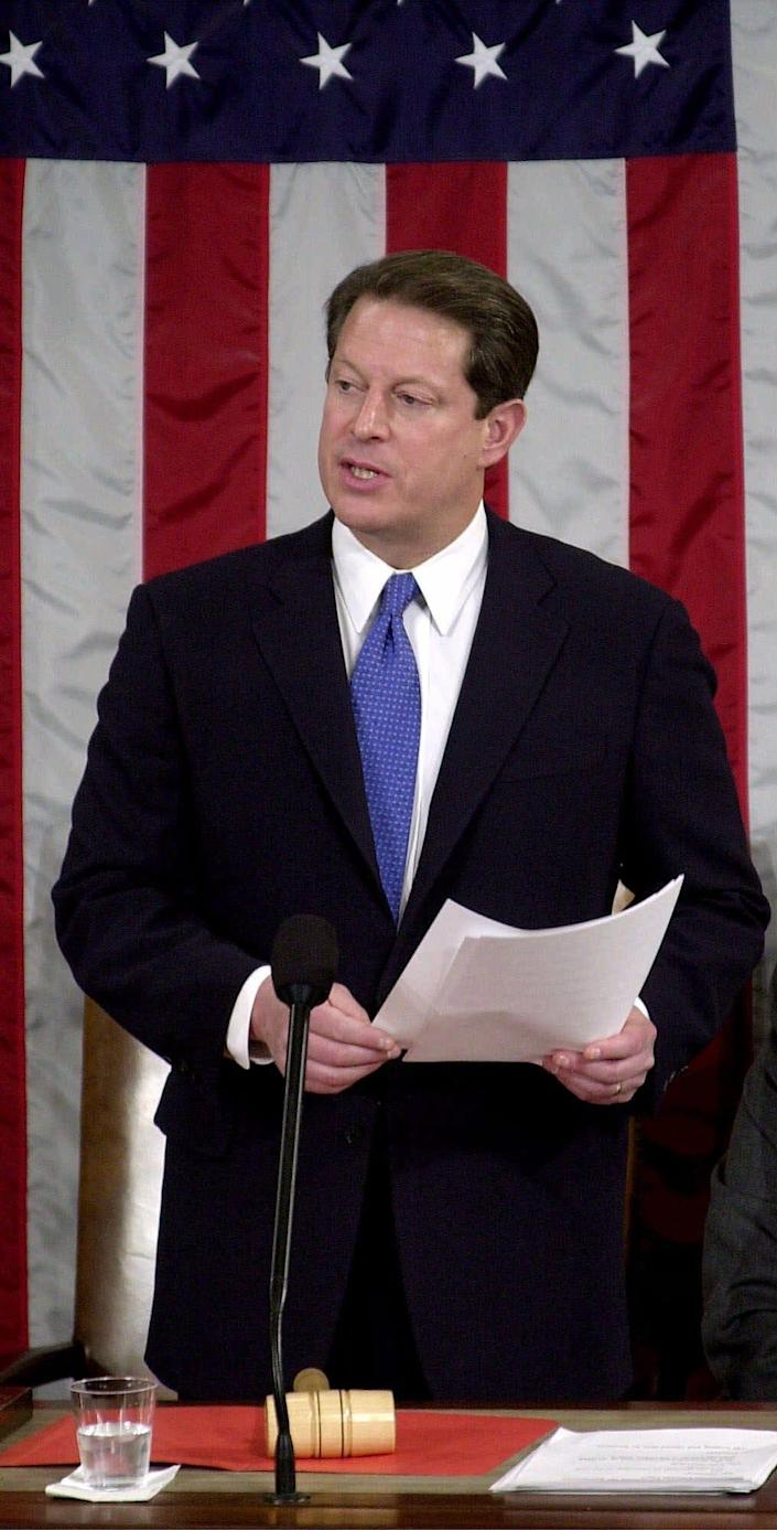 On Capitol Hill, Vice President Al Gore, who lost his bid for president, reads the final results of the electoral vote on the floor of the U.S. House of Representatives, during a joint session of Congress in Washington, Saturday, Jan. 6, 2001.