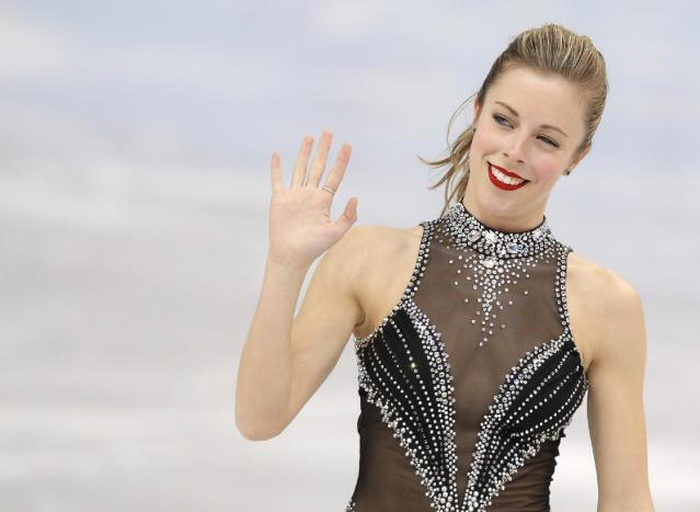Ashley Wagner of the United States waves to spectators after competing in the women's short program figure skating competition at the Iceberg Skating Palace during the 2014 Winter Olympics, Wednesday, Feb. 19, 2014, in Sochi, Russia. (AP Photo/Vadim Ghirda)