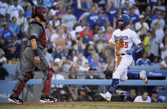 Los Angeles Dodgers' Russell Martin, right, scores on a single by Kristopher Negron as Arizona Diamondbacks catcher Alex Avila stands at the plate during the third inning of a baseball game Saturday, Aug. 10, 2019, in Los Angeles. (AP Photo/Mark J. Terrill)
