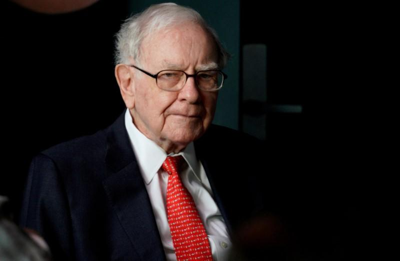 FILE PHOTO: Warren Buffett, CEO of Berkshire Hathaway Inc, pauses while playing bridge as part of the company annual meeting weekend in Omaha