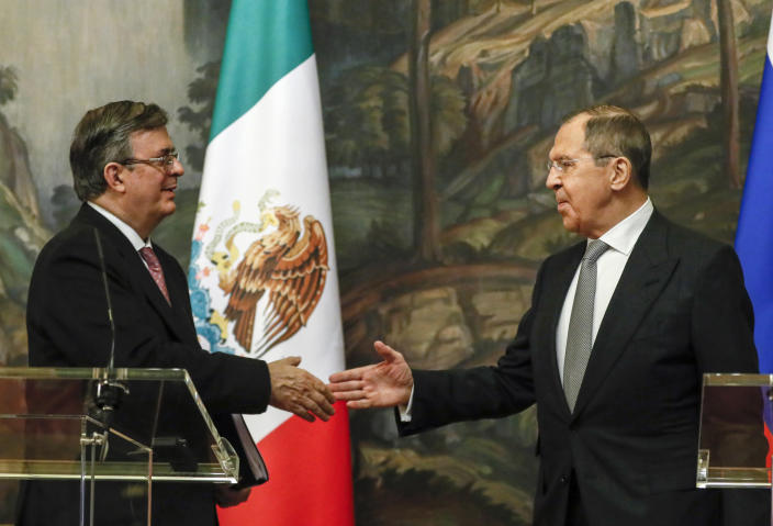 Russian Foreign Minister Sergey Lavrov, right, and Mexican Foreign Minister Marcelo Ebrard shake hands at the press conference after their meeting in Moscow, Russia, Wednesday, April 28, 2021. Mexican Foreign Minister Marcelo Ebrard is on a working visit to Moscow. (Yuri Kochetkov/Pool Photo via AP)