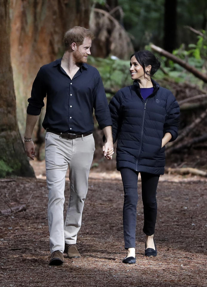 <p>Meghan changed into her Mother slim jeans, flat shoes and a Norrøna coat for a visit to the Redwoods Treewalk. <em>[Photo: Getty]</em> </p>