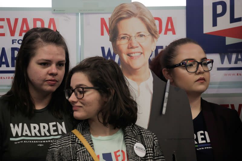 """Supporters listen next to a cardboard cutout of U.S. Democratic presidential candidate Senator Elizabeth Warren during a """"Canvass Kickoff"""" event at Warren's campaign field office in North Las Vegas"""