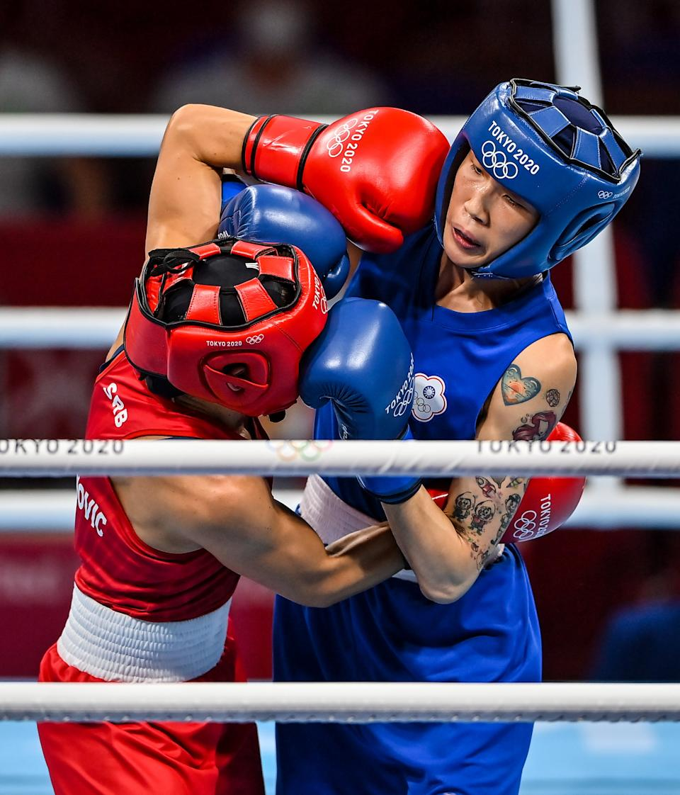 Tokyo , Japan - 1 August 2021; Hsiao-Wen Huang of Chinese Taipei, right, and Nina Radovanovic of Serbia during their women's flyweight quarter-final bout at the Kokugikan Arena during the 2020 Tokyo Summer Olympic Games in Tokyo, Japan. (Photo By Brendan Moran/Sportsfile via Getty Images)