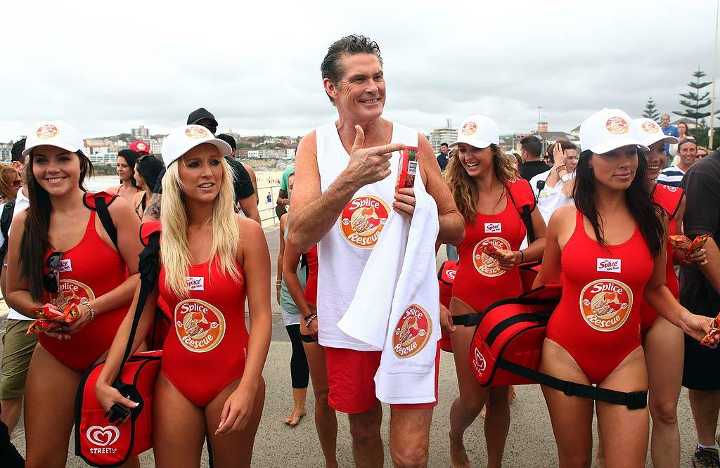 """Sporting red-and-white gear reminiscent of his """"Baywatch"""" days, David Hasselhoff braved a rainy day at Sydney's famed Bondi Beach on Monday to promote an Australian ice cream brand. Sadly, he shot down Internet rumors of a """"Baywatch"""" movie at his Sydney press conference. Would you like to see Mitch Buchannon and his red-suited crew back in action? Don Arnold/WireImage.com To license this image (62930994), contact WireImage.com"""