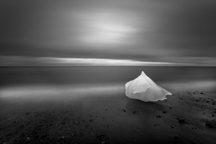 """<b>Honorable Mention: East of Iceland</b> <br> Glacial ice washes ashore after calving off the Breiamerkurjˆkull glacier on Iceland's eastern coast. During the waning light of summer this image was created over the course of a 4 minute exposure while the photographer backlit the grounded glacial ice with a headlamp for 2 of those 4 minutes. <a href=""""http://ngm.nationalgeographic.com/ngm/photo-contest/"""" rel=""""nofollow noopener"""" target=""""_blank"""" data-ylk=""""slk:(Photo and caption by Eric Guth/National Geographic Photo Contest)"""" class=""""link rapid-noclick-resp"""">(Photo and caption by Eric Guth/National Geographic Photo Contest)</a>"""
