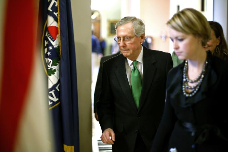 U.S. Senate Minority Leader McConnell returns to his office after a vote to raise the debt ceiling in Washington