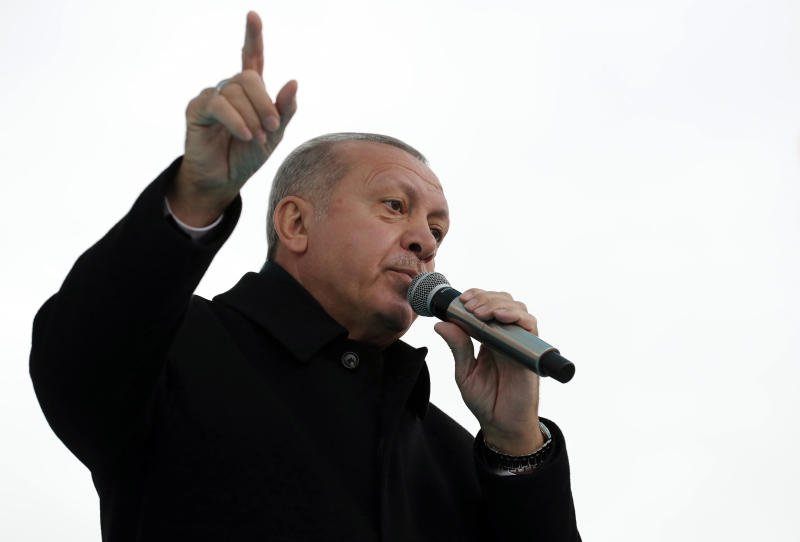 "Turkey's President Recep Tayyip Erdogan addresses the supporters of his ruling Justice and Development Party, AKP, during a rally in Ankara, Turkey, Wednesday, March 13, 2019. Erdogan has laid in to Israeli Prime Minister Benjamin Netanyahu, calling him a ""thief"" and a ""tyrant"" in the latest spat between the two leaders.(Presidential Press Service via AP, Pool)"
