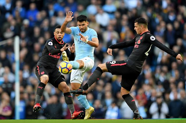 ergio Aguero of Manchester City and Granit Xhaka of Arsenal battle for possession during the Premier League match between Manchester City and Arsenal at Etihad Stadium on November 5, 2017 in Manchester, England.
