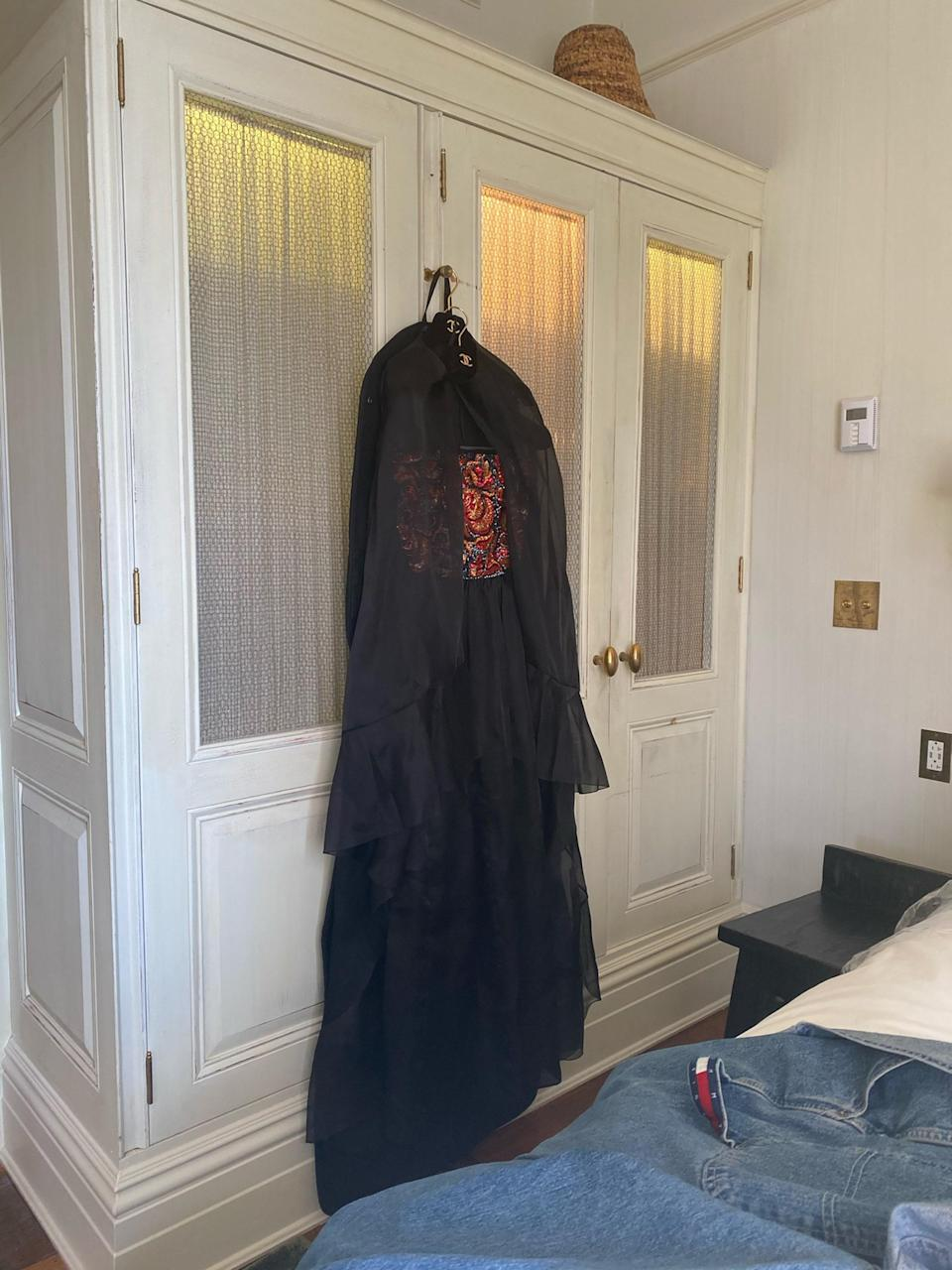 My beautiful CHANEL dress and cape… the details and colors in the bodice were so gorgeous and intricate. + my after-after party overalls laying there in jealousy.