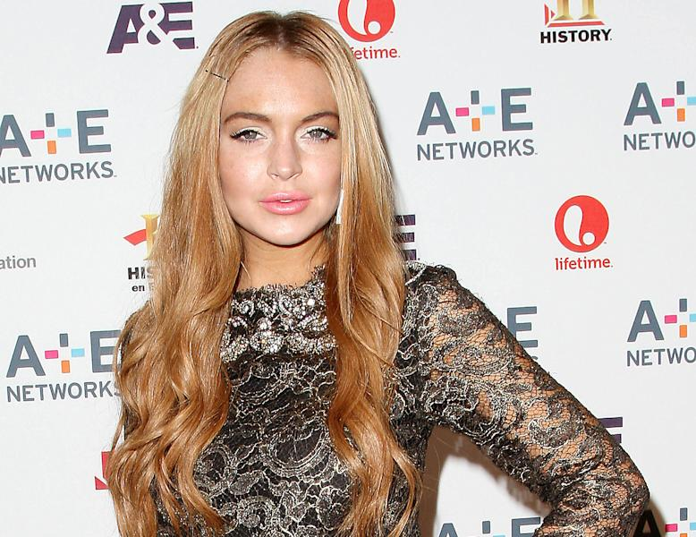 "In this May 9, 2012 photo shows actress Lindsay Lohan at the A&E Networks 2012 Upfront at Lincoln Center in New York. Lohan will star as Elizabeth Taylor in the upcoming Lifetime TV movie ""Liz & Dick."" Police in Santa Monica, Calif., say Lohan was involved in a car accident on Pacific Coast Highway around 11:45 a.m. Friday and that an investigation is ongoing. (AP Photo/Starpix, Kristina Bumphrey, file)"