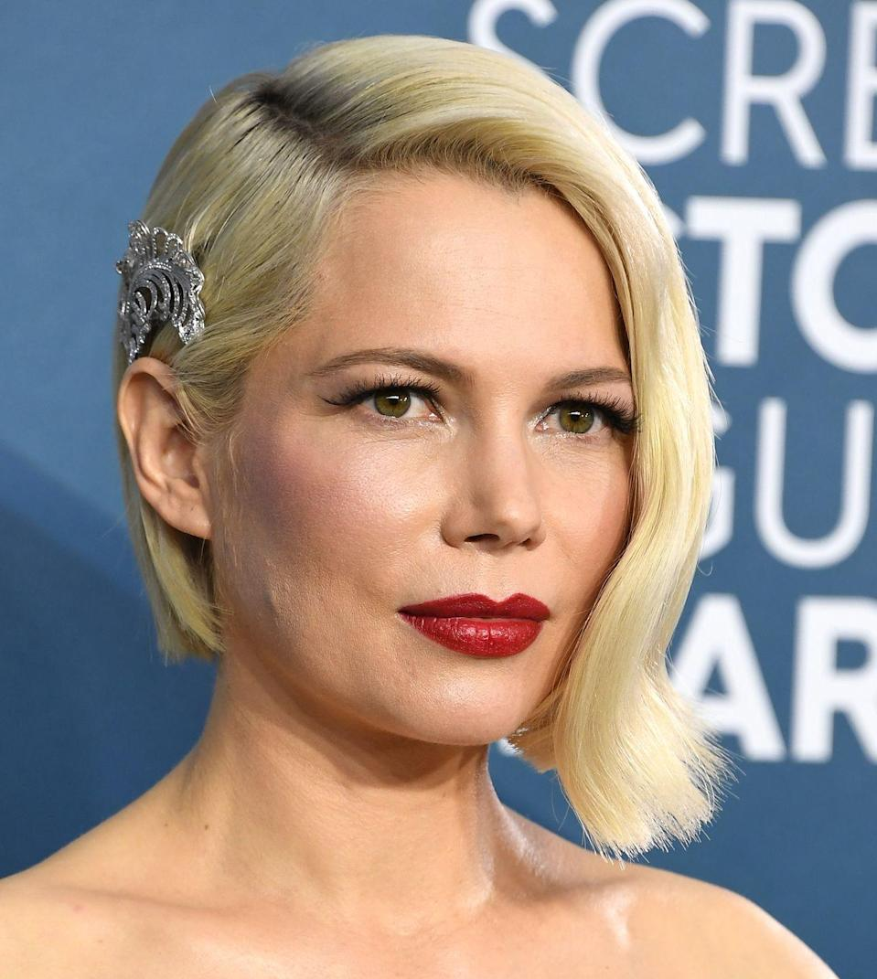 """<p>Modern and sophisticated, actress <strong>Michelle Williams</strong> embodies everything the asymmetrical bob stands for. Her <a href=""""https://www.goodhousekeeping.com/beauty/hair/g30681266/cute-hair-clips-barrettes/"""" rel=""""nofollow noopener"""" target=""""_blank"""" data-ylk=""""slk:hair accessory"""" class=""""link rapid-noclick-resp"""">hair accessory</a> strategically placed behind one ear accentuates this already magnificent look and elevates the fancy factor for a night out. </p>"""
