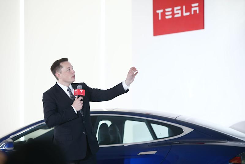 Elon Musk, Chairman, CEO and Product Architect of Tesla Motors, addresses a press conference to declare that the Tesla Motors releases v7.0 System in China on a limited basis for its Model S, which will enable self-driving features such as Autosteer for a select group of beta testers on October 23, 2015 in Beijing, China. (Photo: VCG/VCG via Getty Images