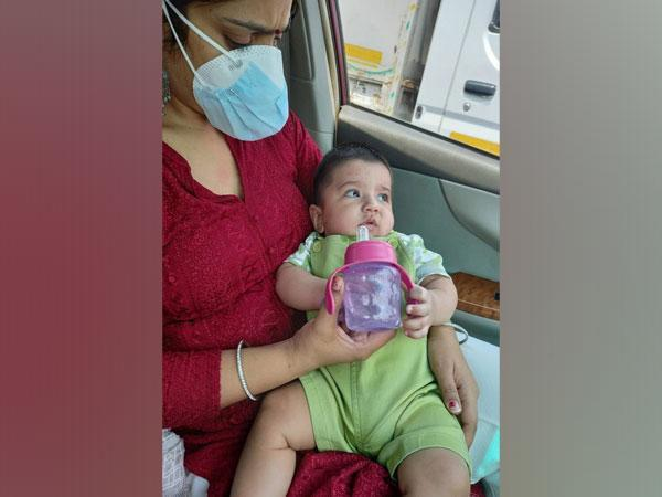 Head constable Rakhi taking care of the baby. (Photo/ANI)
