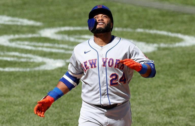 New York Mets star Robinson Cano, here celebrating a home run in August 2020, has been banned 162 games Major League Baseball after testing positive for a banned steroid