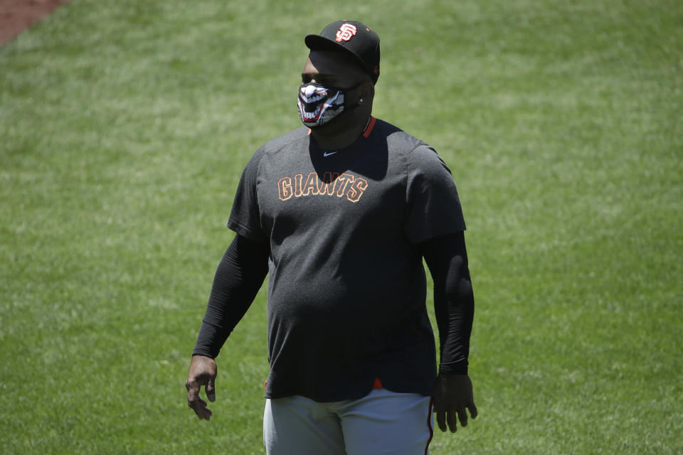 San Francisco Giants' Pablo Sandoval walks on the field during a baseball practice in San Francisco, Sunday, July 5, 2020. (AP Photo/Jeff Chiu)