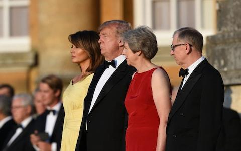 Melania and Donald Trump and Theresa and Philip May outside Blenheim Palace before dinner on Thursday night. - Credit: Geoff Pugh/The Telegraph