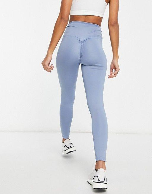 """<p><strong>HIIT</strong></p><p>us.asos.com</p><p><strong>$33.00</strong></p><p><a href=""""https://go.redirectingat.com?id=74968X1596630&url=https%3A%2F%2Fwww.asos.com%2Fus%2Fhiit%2Fhiit-ruched-shaper-leggings-in-powder-blue%2Fprd%2F21797624&sref=https%3A%2F%2Fwww.cosmopolitan.com%2Fhealth-fitness%2Fg26305843%2Fbutt-sculpting-leggings%2F"""" rel=""""nofollow noopener"""" target=""""_blank"""" data-ylk=""""slk:SHOP NOW"""" class=""""link rapid-noclick-resp"""">SHOP NOW</a></p><p>Get all the bawdy-yawdy vibes from these ruched pair. The high rise and wide-cut elasticated waist style will really boost that butt on up. </p>"""