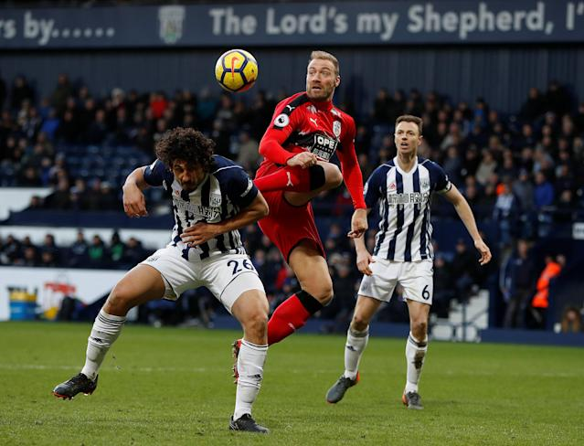 """Soccer Football - Premier League - West Bromwich Albion vs Huddersfield Town - The Hawthorns, West Bromwich, Britain - February 24, 2018 West Bromwich Albion's Ahmed Hegazi in action with Huddersfield Town's Laurent Depoitre Action Images via Reuters/Paul Childs EDITORIAL USE ONLY. No use with unauthorized audio, video, data, fixture lists, club/league logos or """"live"""" services. Online in-match use limited to 75 images, no video emulation. No use in betting, games or single club/league/player publications. Please contact your account representative for further details."""
