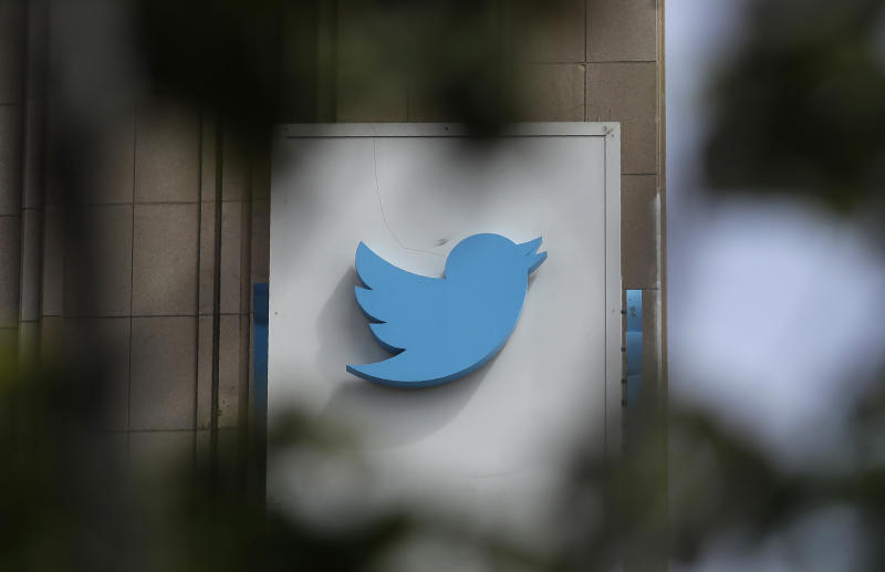 FILE - This July 9, 2019, file photo shows a sign outside of the Twitter office building in San Francisco. Social media companies have vowed to tackle misinformation in politics. Social media companies have vowed to tackle misinformation in politics. But when Britain's Conservative Party changed its press office Twitter account Tuesday, Nov. 19, to look like a fact-checking site during a televised debate, the only consequence was a promise from Twitter to take action if they did it again. (AP Photo/Jeff Chiu, File)