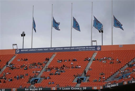 Miami Dolphins team flags fly at half staff in remembrance of 20 children and 6 teachers killed Friday in a shooting rampage at Sandy Hook Elementary School in Newton, Conn. before the first half of an NFL football game, Sunday, Dec. 16, 2012, in Miami. A gunman walked into Sandy Hook Elementary School in Newtown, Conn. Friday and opened fire, killing 26 people. (AP Photo/Wilfredo Lee)