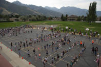Students at Canyon View Elementary in Cottonwood Heights line up on the playground as they go back to school for the first day of classes for the Canyons School District on Monday, August 24, 2020, with parents asked to stay back on the playground lawn while they wait for first bell. (Francisco Kjolseth/The Salt Lake Tribune via AP)