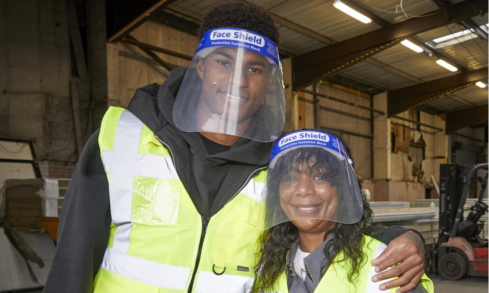 Marcus Rashford and his mother, Melanie, visit FareShare in Greater Manchester on 22 October. Photograph: Mark Waugh/AP