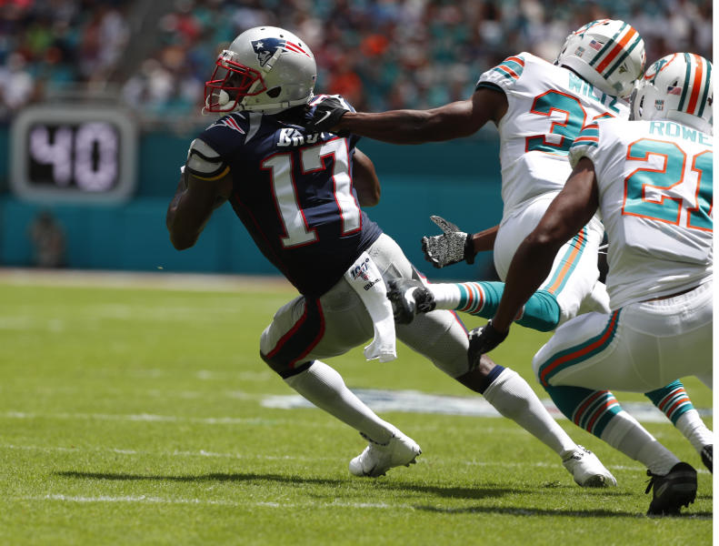 New England Patriots wide receiver Antonio Brown (17) gets away from Miami Dolphins cornerbacks Jomal Wiltz (33) and Miami Dolphins cornerback Eric Rowe (21) during the first half of an NFL football game against the Miami Dolphins, Sunday, Sept. 15, 2019, in Miami Gardens, Fla. (AP Photo/Wilfredo Lee)