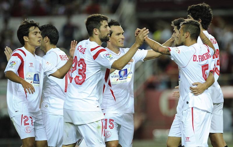 Sevilla players celebrate after scoring during a Spanish league match in Sevilla on May 18, 2014 (AFP Photo/Gogo Lobato)