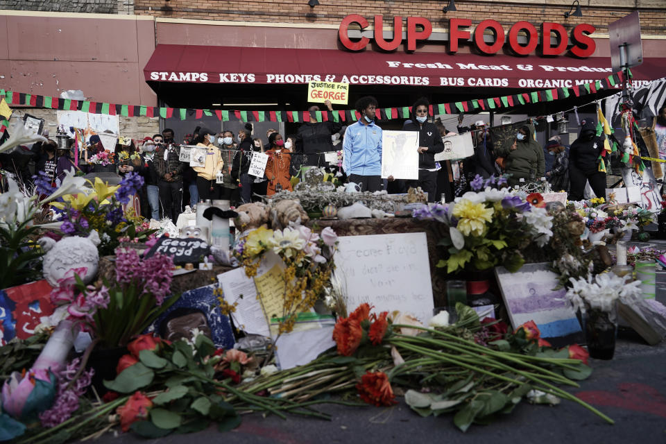 People gather at Cup Foods after a guilty verdict was announced at the trial of former Minneapolis police Officer Derek Chauvin for the 2020 death of George Floyd, Tuesday, April 20, 2021, in Minneapolis, Minn. Former Minneapolis police Officer Derek Chauvin has been convicted of murder and manslaughter in the death of Floyd. (AP Photo/Morry Gash)