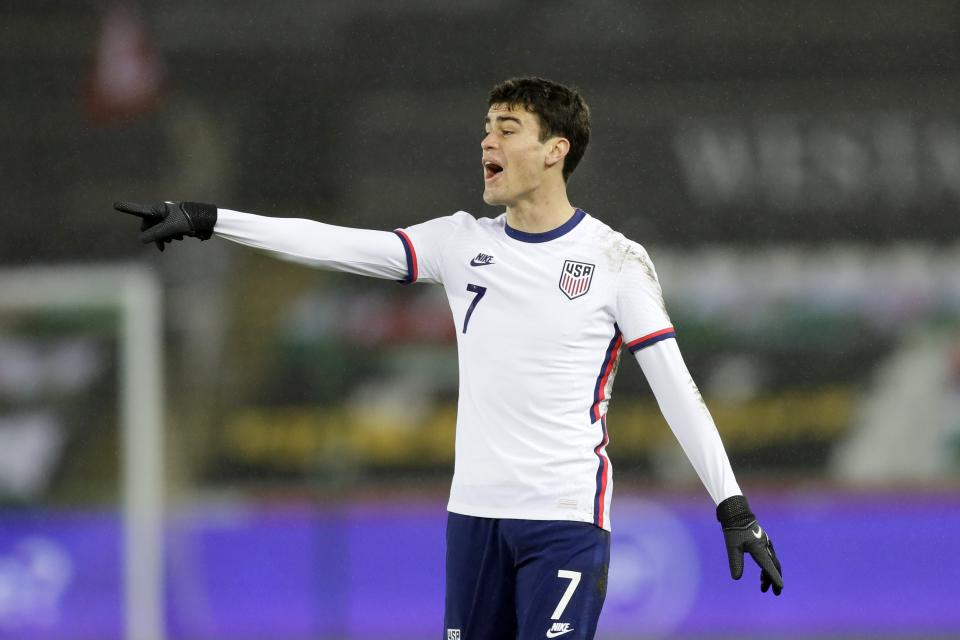 United States' Giovanni Reyna instructs his teammates during the international friendly soccer match between Wales and USA at Liberty stadium in Swansea, Wales, Thursday, Nov. 12, 2020. (AP Photo/Kirsty Wigglesworth)