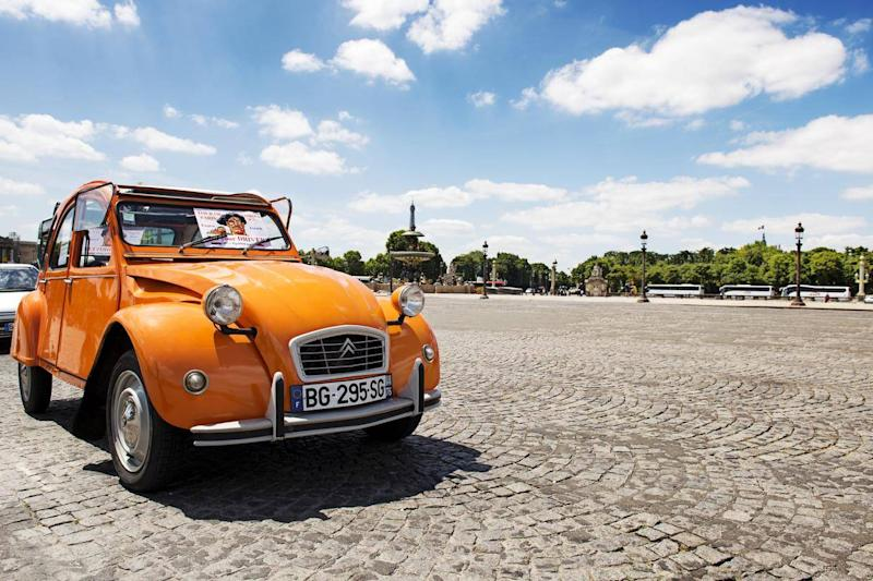 Drive a classic car through the French capital (Getty)