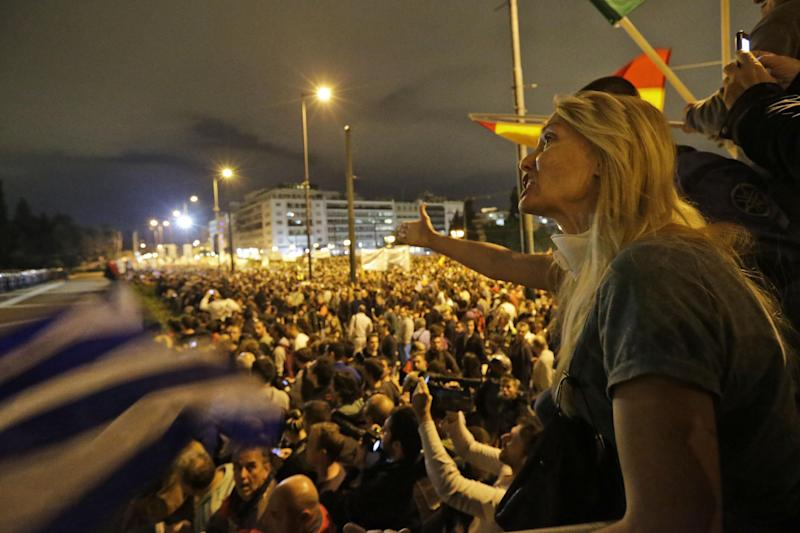 A protester shouts anti-government slogans during a demonstration outside the parliament in Athens, Wednesday Nov. 7, 2012. Greece's fragile coalition government faces its toughest test so far when lawmakers vote later Wednesday on new painful austerity measures demanded to keep the country afloat, on the second day of a nationwide general strike. The euro 13.5 billion ($17.3 billion) package is expected to scrape through Parliament, following a hasty one-day debate. (AP Photo/Lefteris Pitarakis)