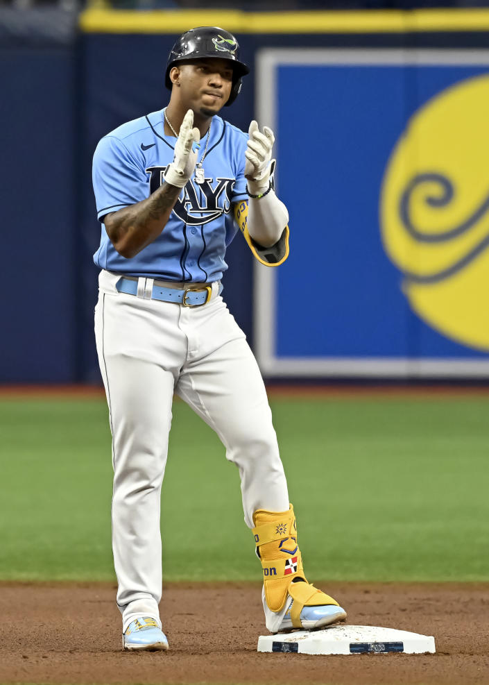 Tampa Bay Rays' Wander Franco claps on second base after hitting a double off Miami Marlins starter Jesus Luzardo during the first inning of a baseball game Sunday, Sept. 26, 2021, in St. Petersburg, Fla. Franco extended his on-base consecutive game streak to 41. (AP Photo/Steve Nesius)