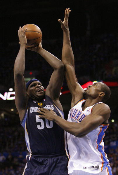 Memphis Grizzlies Zach Randolph, left, shoots as Oklahoma City Thunder's Serge Ibaka defends during the fourth quarter of Game 1 of their Western Conference Semifinals NBA basketball playoff series in Oklahoma City, Sunday, May 5, 2013. Oklahoma City won 93-91. (AP Photo/Alonzo Adams)
