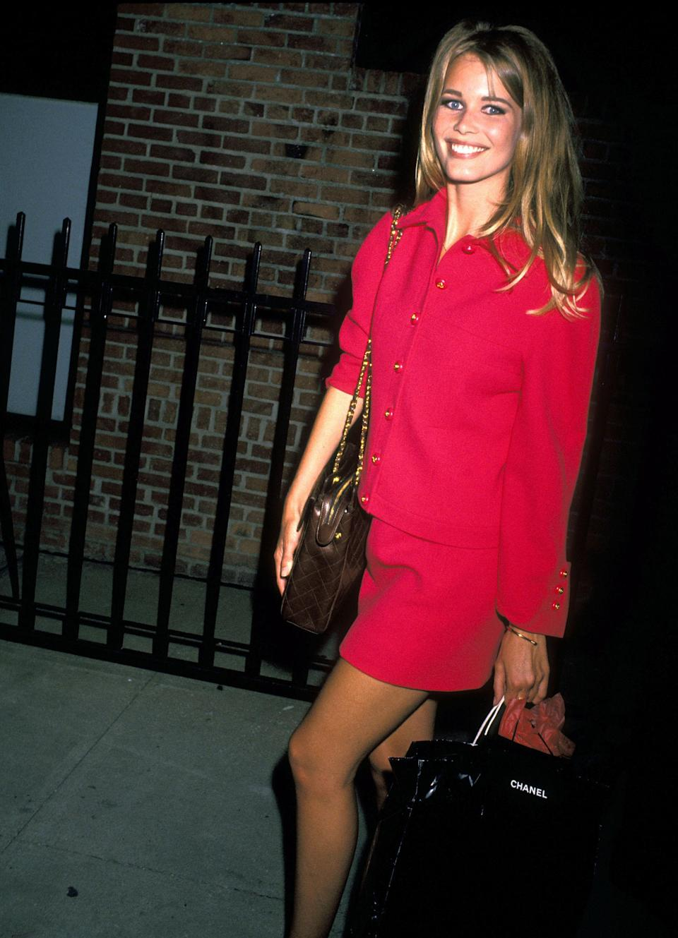 <p>Fuchsia pink is the colour of choice for Schiffer at a Chanel event, 1991</p>