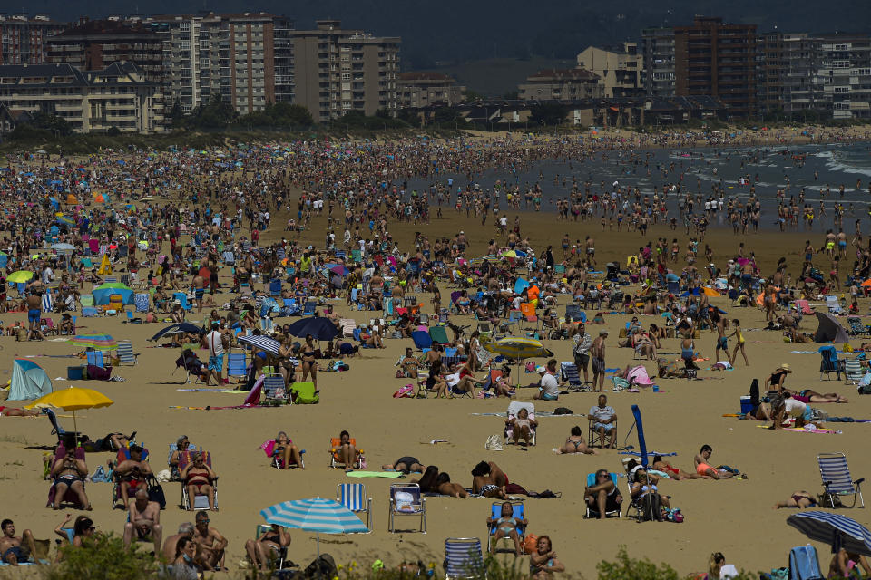 People on the beach during a summer's day, in Laredo, northern Spain, Saturday, July 17, 2021. (AP Photo/Alvaro Barrientos)
