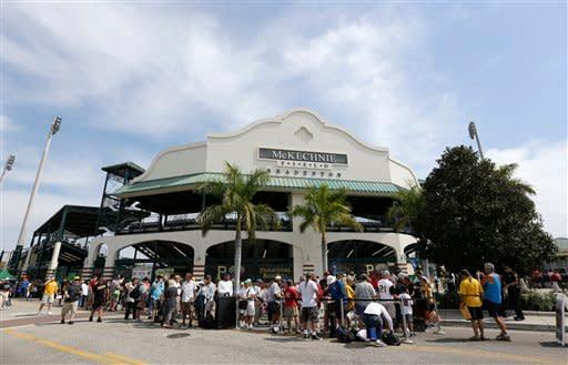 Baseball fans gather outside McKechnie Field, home of the Pittsburgh Pirates before an exhibition spring training baseball game against the Minnesota Twins, Saturday, March 9, in Bradenton, Fla. (AP Photo/Carlos Osorio)