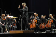 CORRECTS SPELLING OF FIRST NAME TO ESA INSTEAD OF ESSA - Guest conductor Esa-Pekka Salonen, music director of the San Francisco Symphony and principal conductor of London's Philharmonia Orchestra, leads the New York Philharmonic as the orchestra performs before a live audience of 150 people for the first time since March 10, 2020, at The Shed in Hudson Yards, Wednesday, April 14, 2021, in New York. (AP Photo/Kathy Willens)