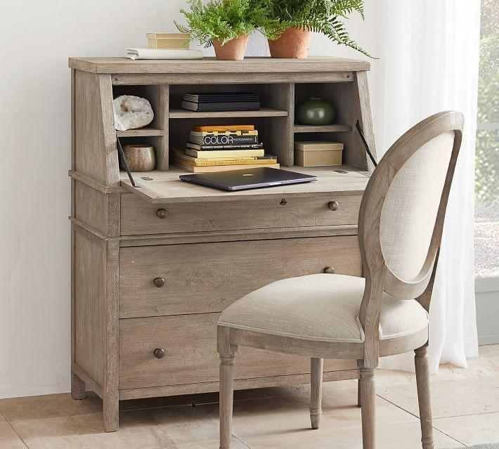 """<p>potterybarn.com</p><p><strong>$1234.00</strong></p><p><a href=""""https://go.redirectingat.com?id=74968X1596630&url=https%3A%2F%2Fwww.potterybarn.com%2Fproducts%2Ftoulouse-secretary-desk%2F&sref=https%3A%2F%2Fwww.countryliving.com%2Fhome-design%2Fdecorating-ideas%2Fg29307726%2Fdesks-for-small-spaces%2F"""" rel=""""nofollow noopener"""" target=""""_blank"""" data-ylk=""""slk:Shop Now"""" class=""""link rapid-noclick-resp"""">Shop Now</a></p><p>It disguises itself as a chic cabinet, but you can bust out the desk and get down to business at a moment's notice.</p>"""